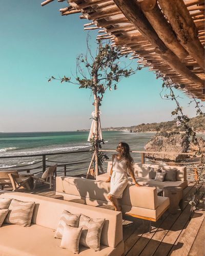 Bali Cozy Place Sofa Leaning One Woman Only White Dress Vacations Relaxing Moments Ocean View Interrior Beach Club Water Sea Beach Land Nature Sunlight Sky Real People Lifestyles Horizon Women Leisure Activity Sitting Adult Horizon Over Water Outdoors