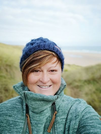a day out on the beach with a walk through the dunes Self Portrait Selfie ✌ Woman Wearing A Warm Hat And Fleece Out For The Day Fresh Air Healthy Lifestyle Warm Clothing Portrait Smiling Winter Looking At Camera Headshot Happiness Cold Temperature Healthy Lifestyle Standing Wool Shore Hiker Horizon Over Water