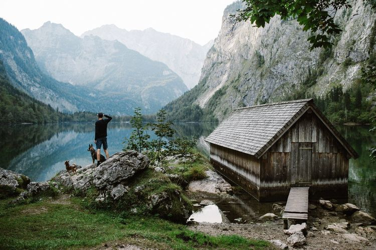 - Obersee - My Year My View Mountain Built Structure Mountain Range Nature Person Dog Beauty In Nature Sky Tree Outdoors People One Man Only One Person Lake Lake View EyeEm Best Shots EyeEm Best Edits Beauty In Nature Animal Friends Animal Green Bavaria Outdoor Portrait