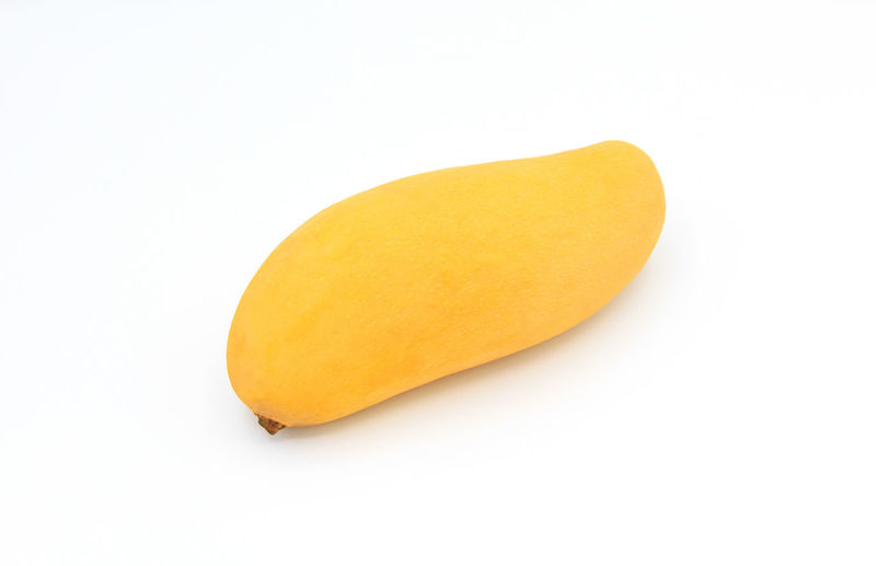 Close-up of orange slice against white background