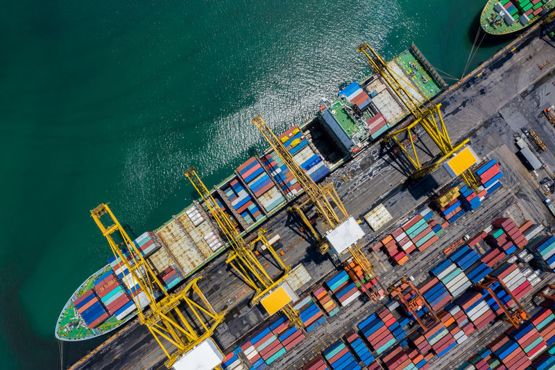 Aerial top view terminal shipping import and export international and shipping loading containers