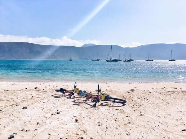 La graciosa in Canary Island Nautical Vessel Day Sea Water Nature Beach Sand Outdoors Scenics Beauty In Nature Vacations Men Women Mountain Real People Horizon Over Water Young Adult SPAIN SPAIN Canary Islands La Graciosa Lanzarote Bycicle Ride Bike