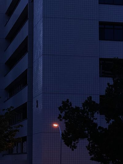 Low angle view of modern building at night