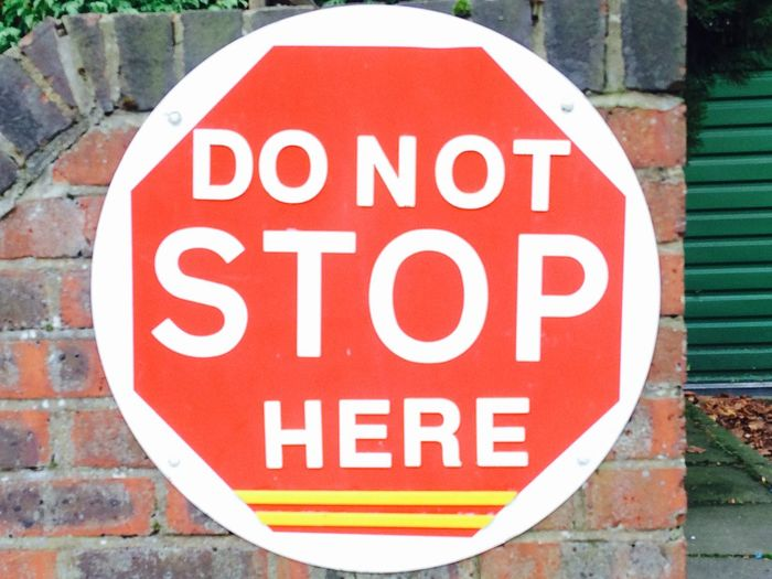Don't Stop Here Communication Dontstop Dontstophere Outdoors Red Road Sign Roadsafety Text Traffic Warning Warning Sign