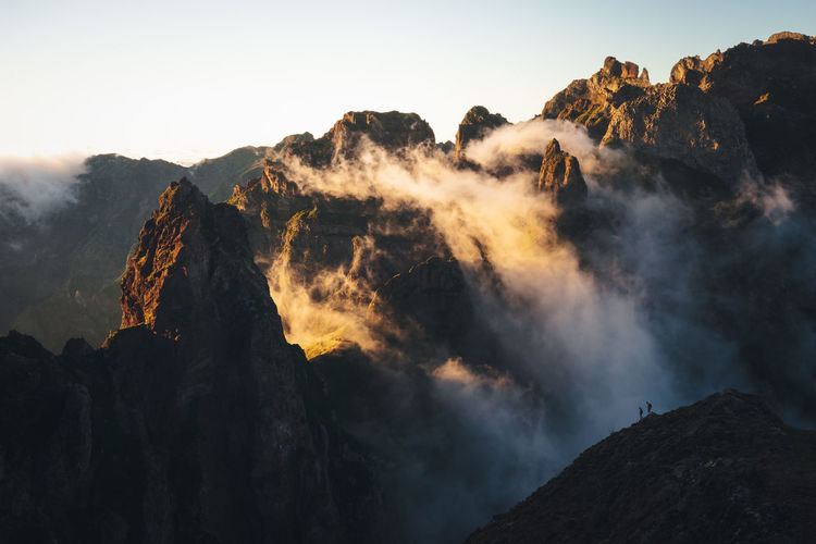Hikers viewing the misty mountains of madeira.