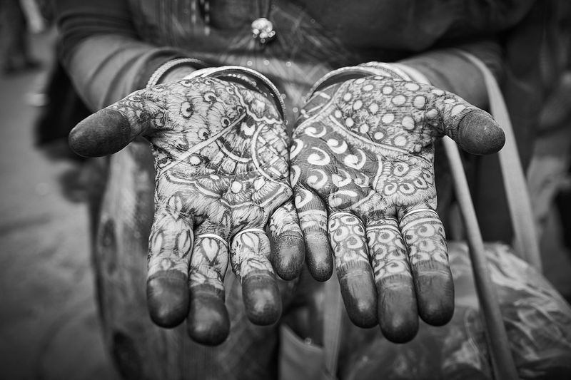 Close-up of woman with tattoo on hand