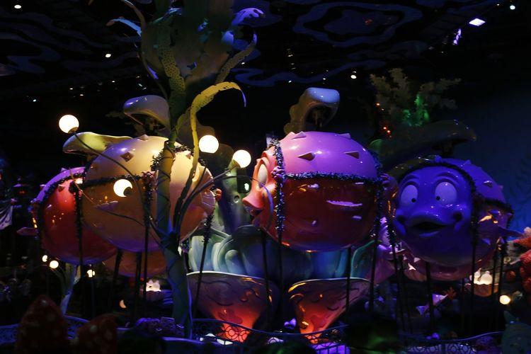 Illuminated lanterns hanging in market at night