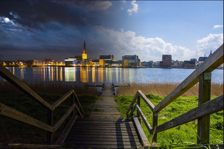 City Cloud Day Germany Illuminated Lake Night Night And Day River Rostock Sky Skyline The Way Forward Tranquility Walkway Water Wood Paneling
