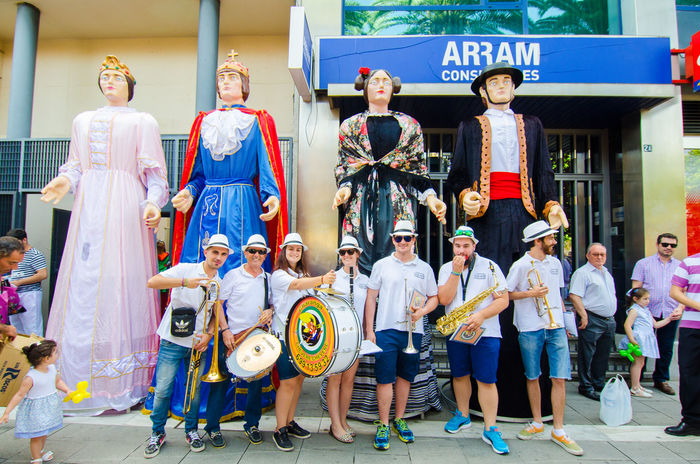 Badajoz, Spain - june 24, 2017: Disguised figures known as giants and big heads, roughly gigantes y cabezudos parade for the children in the city of Badajoz 2017 Badajoz Big Heads Cabezudos Celebration Childs Costumes Culture Day Event Extremadura Extremadura Spain Festival Folklore Fun Giants Outdoors Parade Party San Juan Street Tourism Travel