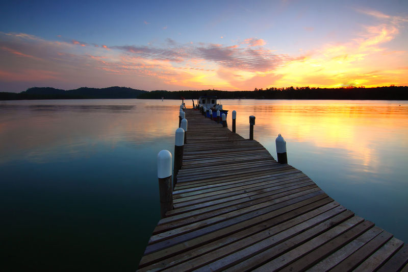 Beauty In Nature Cloud - Sky Direction Idyllic Jetty Lake Nature No People Non-urban Scene Orange Color Outdoors Pier Reflection Scenics - Nature Sky Sunset The Way Forward Tranquil Scene Tranquility Water Wood Wood - Material Wood Paneling