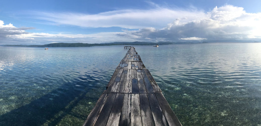 the most beautiful reef in the world Pier Sunrise_Collection Tropical Paradise Beauty In Nature Cloud - Sky Day Nature No People Outdoors Rajaampatisland Scenics Sea Sky Tranquil Scene Tranquility Water Westpapua Wood - Material Wood Paneling