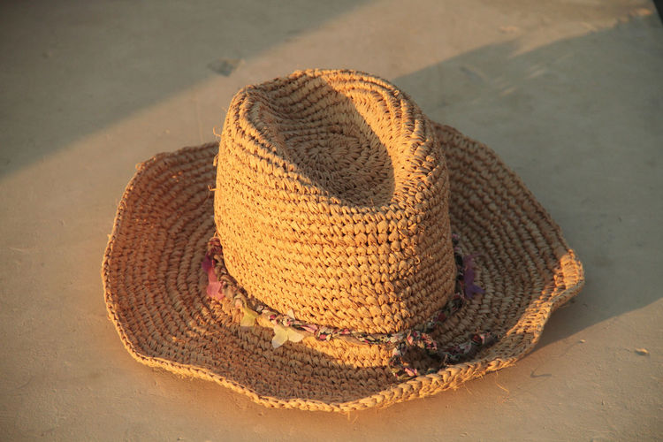 Accessories Beach Brown Close-up Day Design Hat High Angle View Natural Pattern Nature Pattern Protection Sand Seashell Shadow Single Object Still Life Straw Hat Summer Sunlight Textured