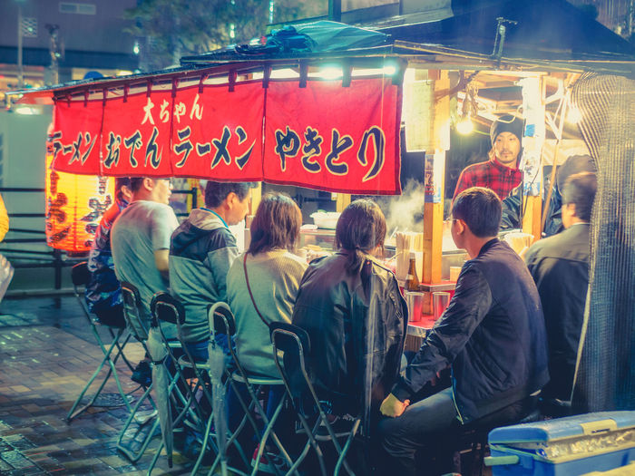 Ramen joints in Fukuoka Fukuoka,Japan Japan Japan Photography Nightphotography Architecture Building Exterior City Communication Day Food Fukuoka Group Of People Large Group Of People Men Nakasu Outdoors People Real People Street Streetphotography Togetherness
