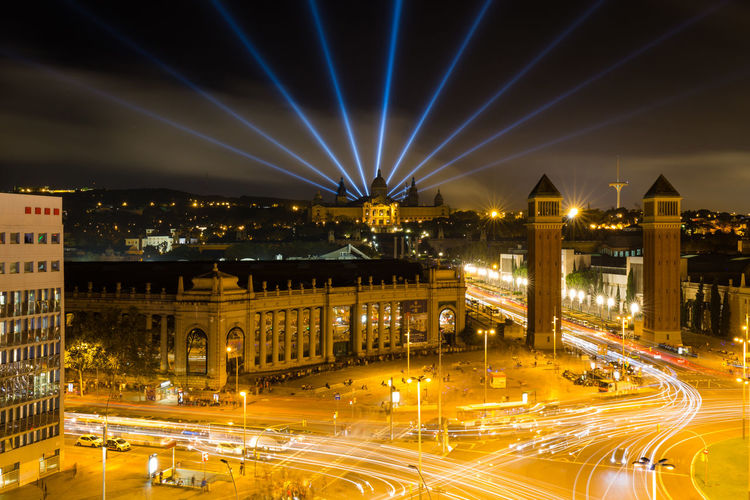 Long Exposure with light trails of the Plaza España and the illuminated National museum of of Catalonia (MNAC: Museu Nacional d'Art de Catalunya) in the background Illuminated Night Architecture Built Structure City Light Beam Building Exterior Street Long Exposure Transportation Light Trail Motion Road Light Barcelona Plaza España Museum Roundabout Traffic Cityscape Catalonia SPAIN MNAC