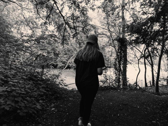 Rear view of a woman walking on tree