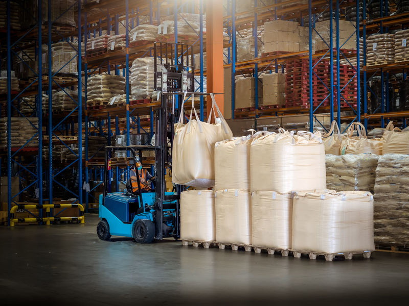 Forklift is handling jumbo bags in large warehouse. Delivery Forklift Jumbo Racking  Rice Sugar Bags Day Export Factory Import Indoors  Industry Machinery Manufacturing Equipment No People Pallet Rack Silica Silicon Stack Tapioca Warehouse