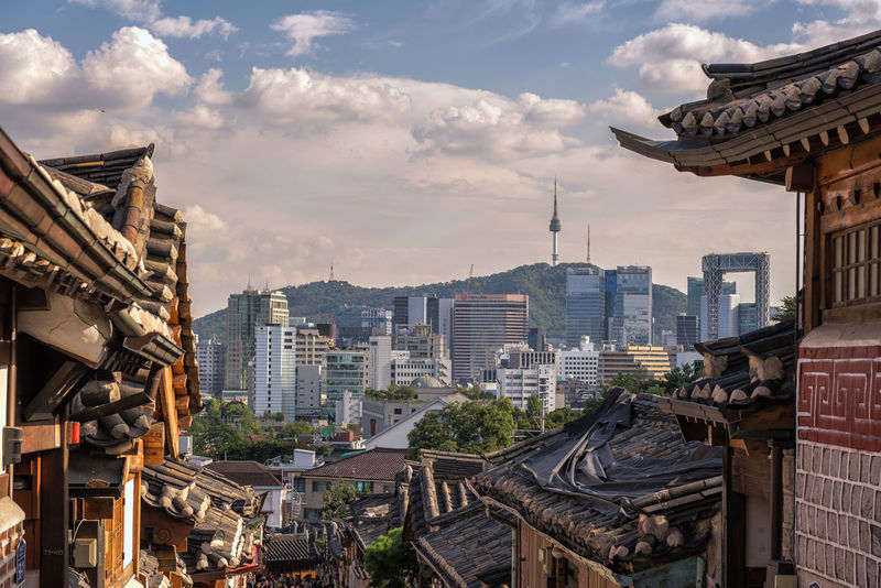 Bukchon Hanok Village of seoul city in Korea. Architecture Asia; Architecture; Travel; City; Style; Korean Building Exterior Built Structure City Cityscape Cloud - Sky Day Hanok; Bukchon; Korea; Seoul; Village; South; Traditional; House No People Outdoors Roof Sky Travel Destinations