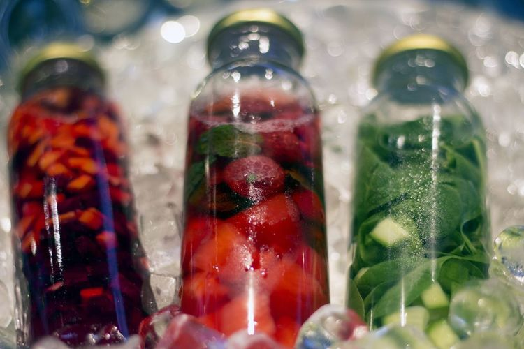 Close-up of fruit juices in bottles