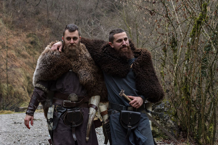 Portrait of two warriors walking in forest