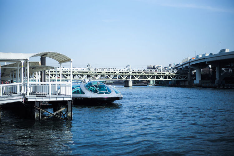 Sumida river Tokyo Sumida River Tokyo Architecture Bridge Bridge - Man Made Structure Building Exterior Built Structure Clear Sky Copy Space Day Luxury Mode Of Transportation Nature Nautical Vessel No People Outdoors Passenger Craft Sea Sky Transportation Travel Water Waterfront