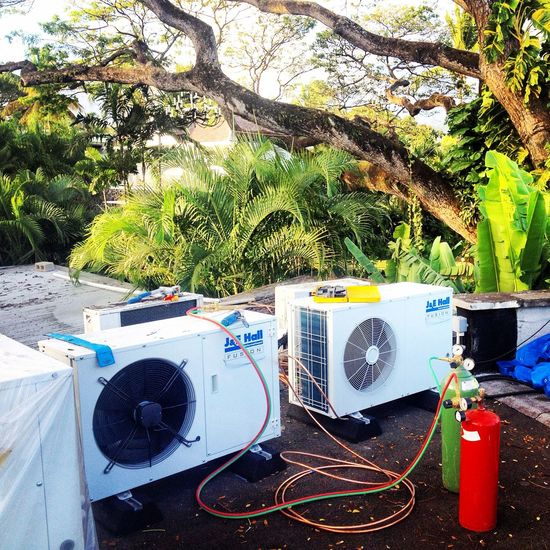 Working in paradise Work HVAC Refrigeration Brazing Palm Trees Hot Day