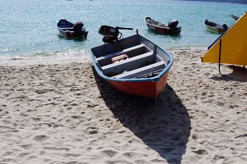 Boat Sand Beach Nautical Vessel Water Sea Transportation Nature Day Mode Of Transport Outdoors No People Vacations Beauty In Nature