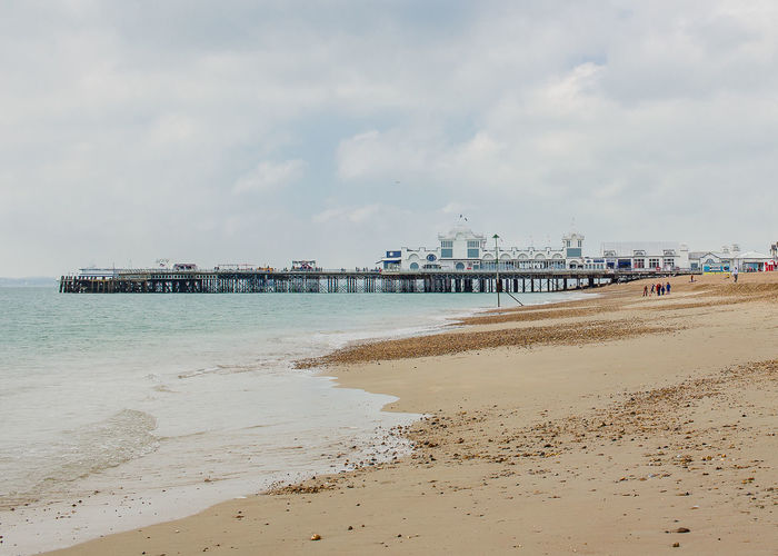 Portsmouth Architecture Beach Beauty In Nature Building Exterior Built Structure Cloud - Sky Day Incidental People Land Nature Outdoors Pier Sand Scenics - Nature Sea Sky Southsea Tranquil Scene Tranquility Water