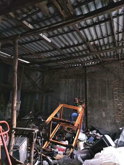 People working in abandoned building