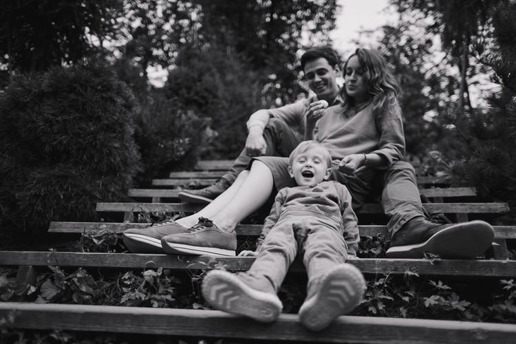 Happy family in spring or summer park Family Lifestyle Adult Bonding Casual Clothing Couple - Relationship Day Emotion Full Length Leisure Activity Lifestyles Love Males  Men Outdoors People Positive Emotion Real People Sitting Toddler  Togetherness Women