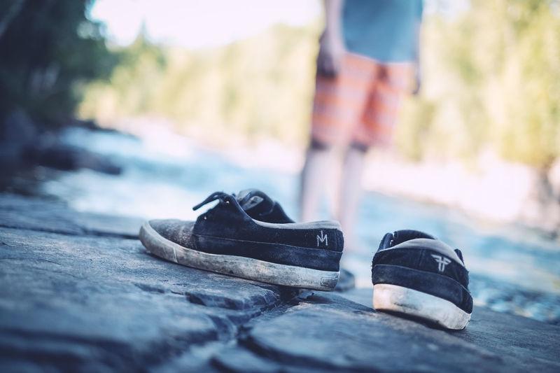 Boy Camping Distance Leftbehind Rocks Shoes Shorts Standing Water Wet Rocks
