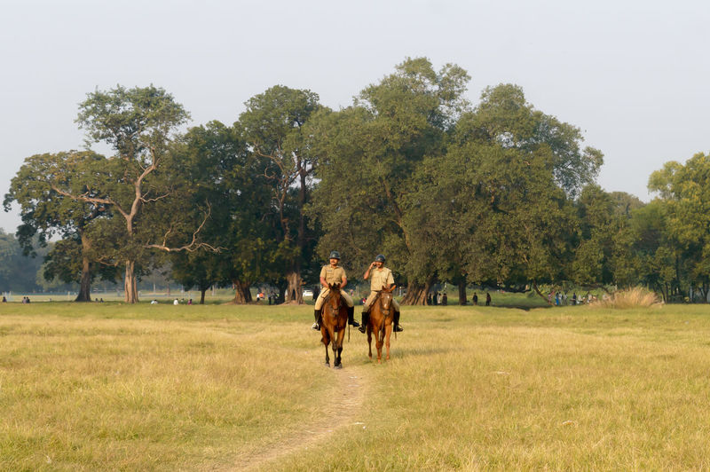 Group of people walking on field