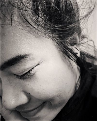 Close-Up Of Smiling Woman With Closed Eyes