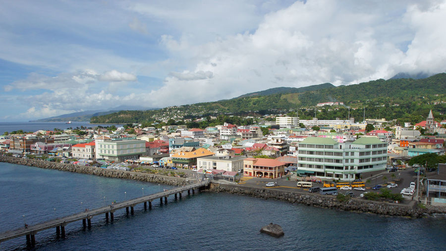 Panorama of Roseau, Dominica, Caribbean Architecture Building Exterior Built Structure Caribbean Central America City Cityscape Dominica Harbor Landscape Mountain Range Outdoors Panorama Roseau Scenery Scenics Skyline Tourism Tourist Attraction  Town Travel Travel Destinations Water West Indies Winward Islands