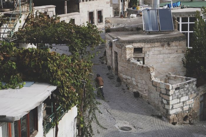 Walking in the alleyway. Architecture Built Structure Building Exterior Real People One Person Outdoors Walking Around Leisure Activity Enjoy The New Normal Old Buildings Old Town Old Tranquil Scene Street View View From Above Across The Street Crossing Pathway Alleyway Cappadocia Cappadocia/Turkey Old City Street Photography Finding New Frontiers Miles Away