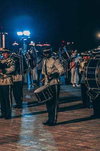 The drummer Band Drummer Night Group Of People Music Crowd Real People Performance Arts Culture And Entertainment City People Musical Instrument Men Illuminated Musician Musical Equipment Event Street Lifestyles Enjoyment Nightlife The Still Life Photographer - 2018 EyeEm Awards