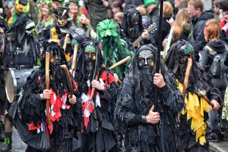 Traditional Clothing Tradition Arts Culture And Entertainment Day Outdoors Travel Destinations People Real People Crowd Adult City Adults Only Jack In The Green Festival Jack In The Green May Day 2017 East Sussex Hastings Pagan Community Pagan Festival Masks Carnival Traditional Dancing Focus On Foreground Cultures