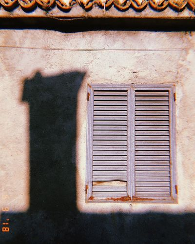 Old and particular Built Structure Architecture No People Window Building Exterior Day Wall - Building Feature Metal Old Weathered Sunlight Pattern Building Closed Outdoors Wall Security Shadow Safety Shutter