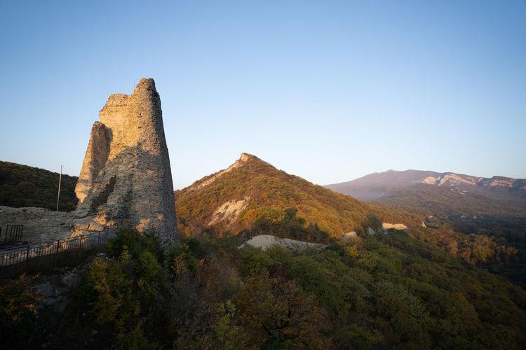 Castle on mountain against clear sky