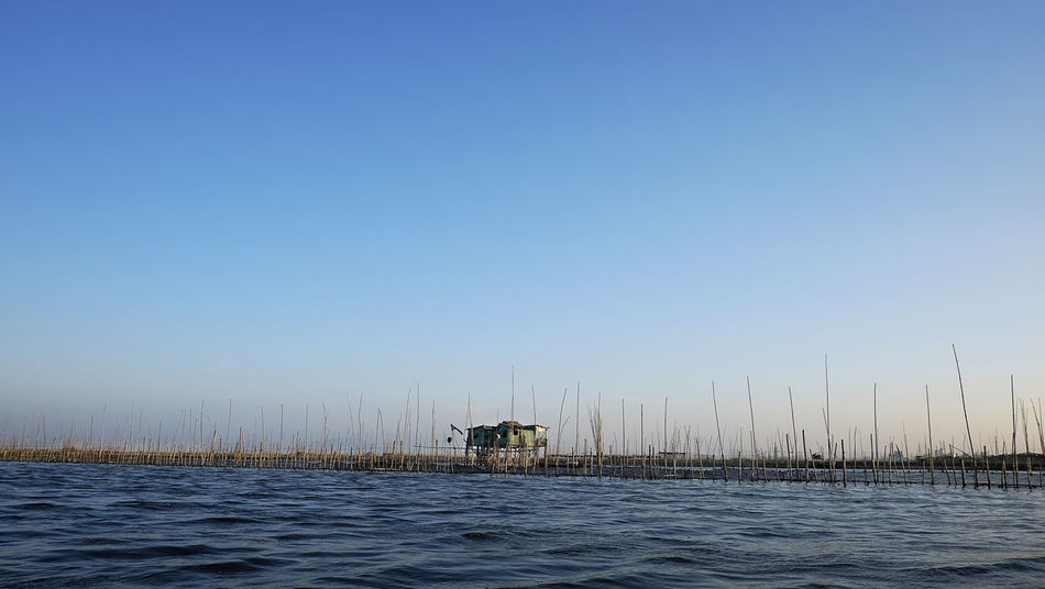 In the middle of the bay. Beauty In Nature Blue Clear Sky Fishpond Fresh Water Laguna De Bay Landscapes With WhiteWall Nature Nipahut No People Outdoors Philippines Scenics Sky Sunset #sun #clouds #skylovers #sky #nature #beautifulinnature #naturalbeauty #photography #landscape Sunset_collection Tranquility Water