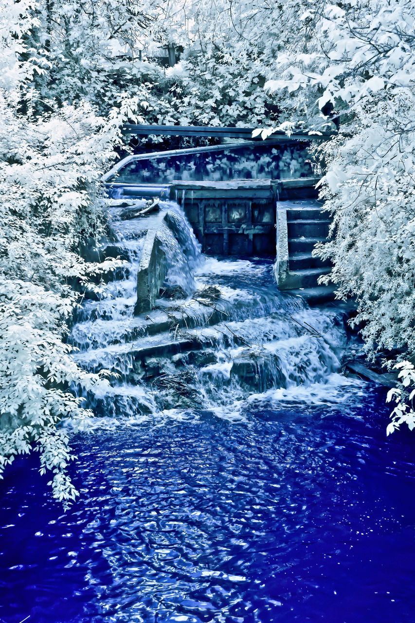 water, architecture, nature, waterfront, motion, built structure, day, no people, winter, outdoors, cold temperature, blue, sea, snow, building exterior, splashing, beauty in nature, sport, flowing water, icicle, swimming pool, flowing