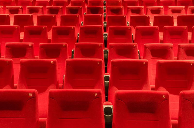 Full frame shot of red empty chairs in stadium