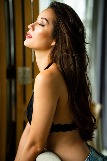 Beautiful young woman with eyes closed