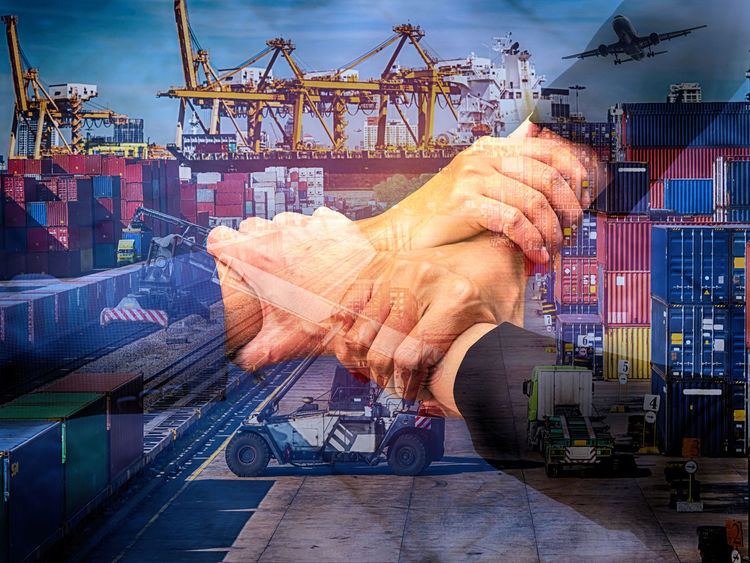 Adult Architecture Built Structure Business Concept Cargo Container City Commercial Dock Crane - Construction Machinery Day Freight Transportation Harbor Human Body Part Human Hand Import/export Industry Outdoors People Shipping  Shipyard Sky Successful Teamwork Concept Transportation Working