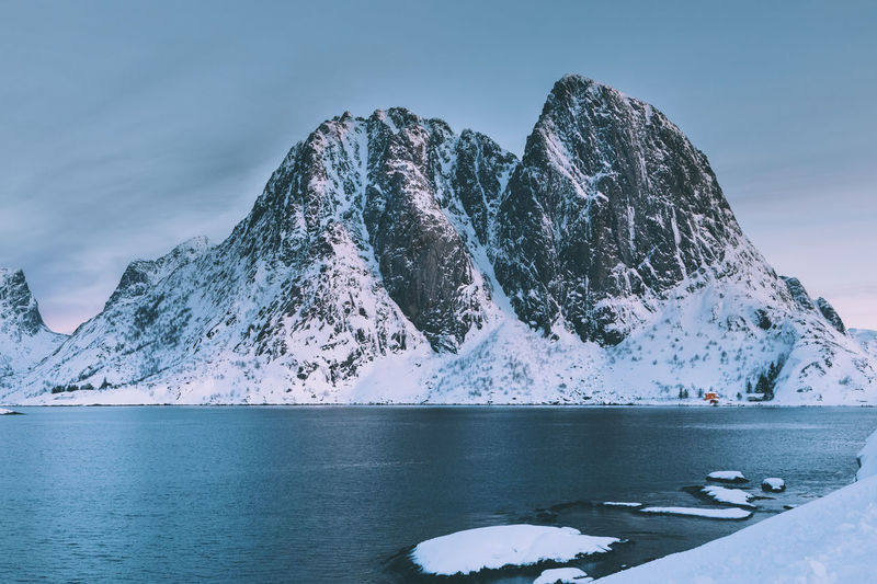 Frozen lake against mountain during winter