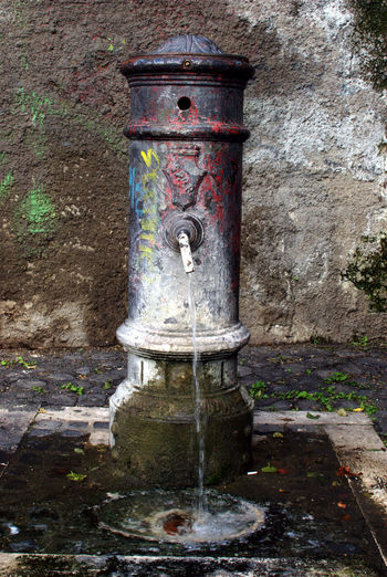 Close-up of water fountain against wall