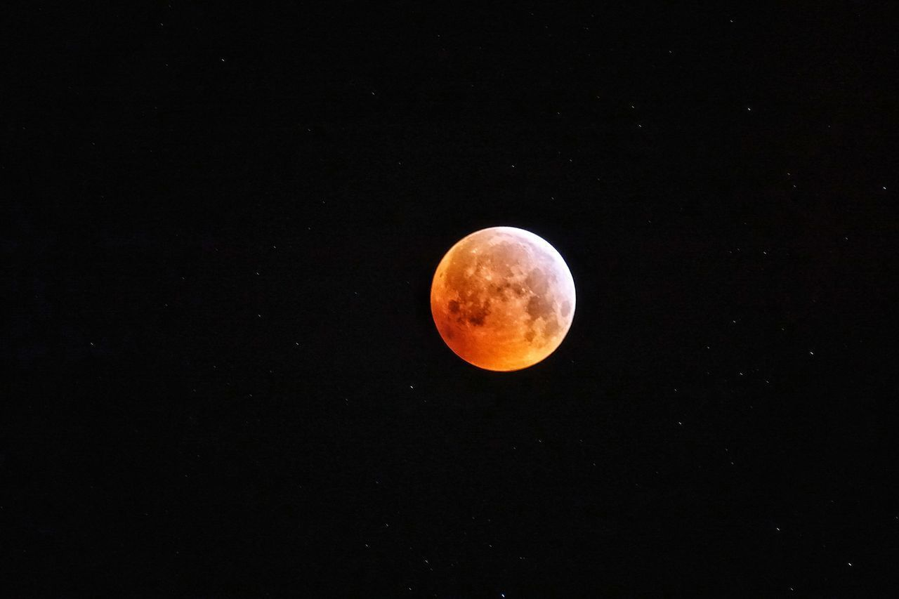 space, astronomy, night, moon, sky, beauty in nature, eclipse, moon surface, planetary moon, scenics - nature, natural phenomenon, full moon, tranquility, orange color, circle, idyllic, geometric shape, tranquil scene, nature, no people, outdoors, space and astronomy