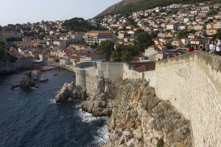 Dubrovnik Dubrovnik, Croatia Croatia Outdoors Cliff Cliffside Walls Fortified Wall Fortified Walls Cityscape Top View View From The Top Architecture Built Structure Building Exterior Water City Building Town Nature Sea Residential District Day High Angle View No People Community Motion TOWNSCAPE