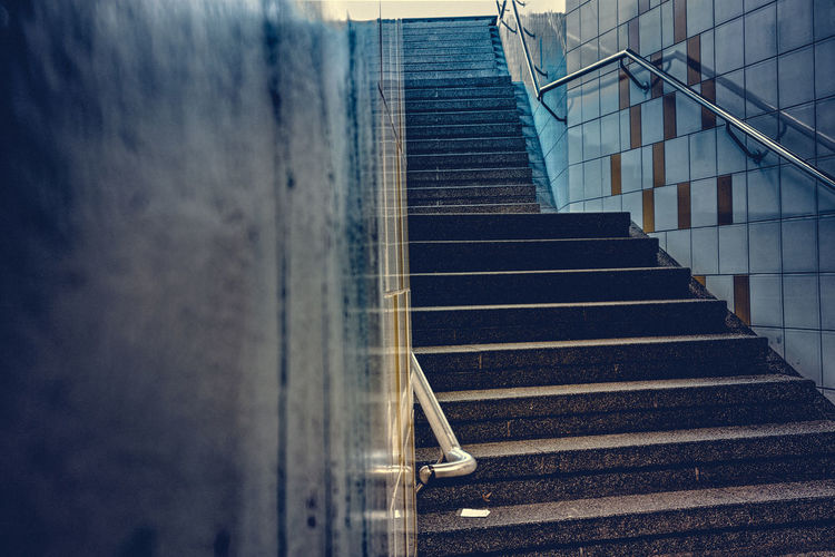 Sense of Dread Anxiety  Blue Day Diminishing Perspective Doorway Dread Empty Eve-teasing Exit Feeling Feeling Of Anxiety Harassment Low Angle View Modern No People Outdoors Sense Sense Of Dread Sky Staircase Stairs Steps Steps And Staircases The Way Forward Trouble