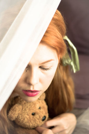 High Angle View Of Redhead Woman With Teddy Bear