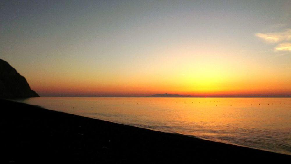 Scenics Beauty In Nature Sea Sunrise Tranquil Scene Water Santorini Santorini, Greece Perissabeach Perissa Santorinigreece